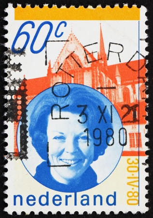 NETHERLANDS - CIRCA 1990: a stamp printed in the Netherlands shows Queen Beatrix and Palace, circa 1990 Stock Photo - 12143565