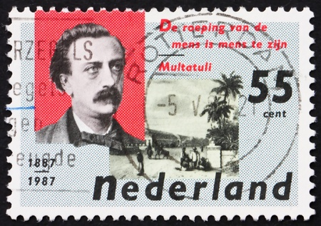 NETHERLANDS - CIRCA 1987: a stamp printed in the Netherlands shows Eduard Douwes Dekker and De Harmonie Club, Batavia, circa 1987 Stock Photo - 12143567
