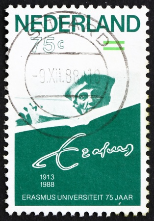 humanist: NETHERLANDS - CIRCA 1988: a stamp printed in the Netherlands shows Erasmus of Rotterdam, 75th Anniversary of Erasmus University, Rotterdam, circa 1988 Stock Photo