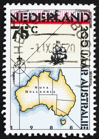 NETHERLANDS - CIRCA 1988: a stamp printed in the Netherlands shows Map of Australia, Bicentennial of Australia, circa 1988 photo
