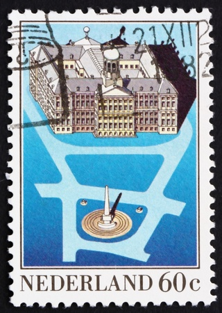 dam square: NETHERLANDS - CIRCA 1983: a stamp printed in the Netherlands shows Royal Palace, Dam Square, Amsterdam, circa 1983
