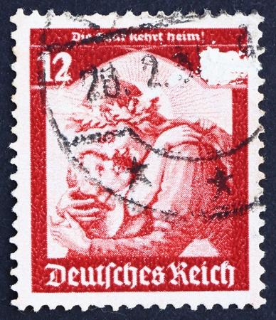 saar: GERMANY - CIRCA 1934: a stamp printed in the Germany shows Germania Welcoming Home the Saar, Saar plebiscite, circa 1934
