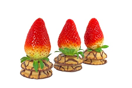 Three fresh ripe strawberry on a cakes in a row isolated on white background photo