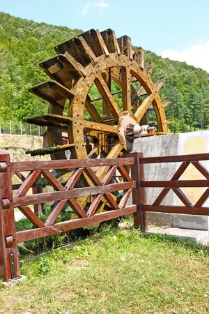 Wooden wheel of an old water mill photo