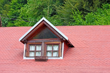asphalt shingles: Old window on red shingled roof