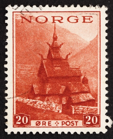 NORWAY - CIRCA 1938: a stamp printed in the Norway shows Borgund Stave Church, circa 1938 Stock Photo - 12179710