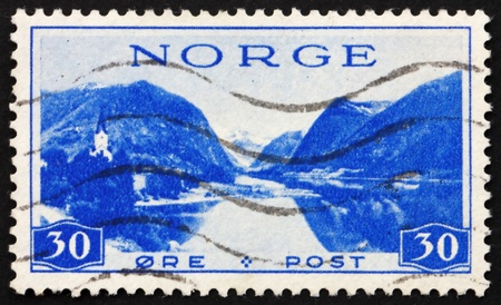 perforated stamp: NORWAY - CIRCA 1938: a stamp printed in the Norway shows Jolster in Sunnfjord, circa 1938