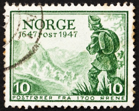 NORWAY - CIRCA 1947: a stamp printed in the Norway shows Letter Carrier, about 1700, circa 1947 photo