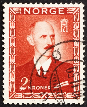 NORWAY - CIRCA 1946: a stamp printed in the Norway shows King Haakon VII, circa 1946 Stock Photo - 12160024