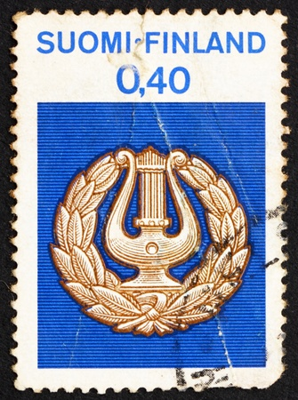 collegian: FINLAND - CIRCA 1968: a stamp printed in the Finland shows Lyre, Students' Emblem, circa 1968 Stock Photo