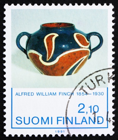 FINLAND - CIRCA 1991: a stamp printed in the Finland shows Iris, Ceramic Vase by Alfred W. Finch, circa 1991 photo
