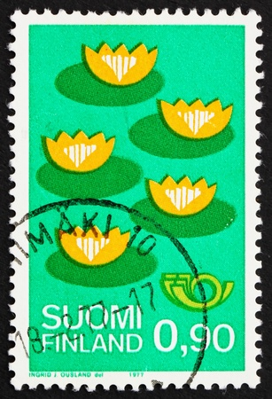 FINLAND - CIRCA 1977: a stamp printed in the Finland shows Five Water Lilies, Nordic Countries Cooperation for Protection of the Environment, circa 1977 photo