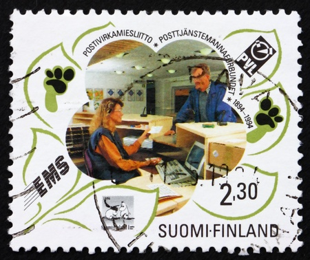 FINLAND - CIRCA 1994: a stamp printed in the Finland shows Postal Service Civil Servants' Federation, Centenary, circa 1994 photo