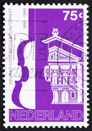 NETHERLANDS - CIRCA 1988: a stamp printed in the Netherlands shows Amsterdam Concertgebouw and Orchestra, centenary, circa 1988 Stock Photo - 12179650