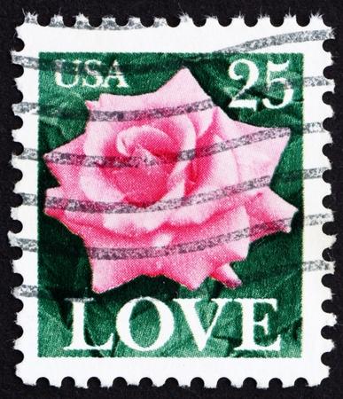 UNITED STATES OF AMERICA - CIRCA 1988: a stamp printed in the United States of America shows Rose flower, circa 1988 photo