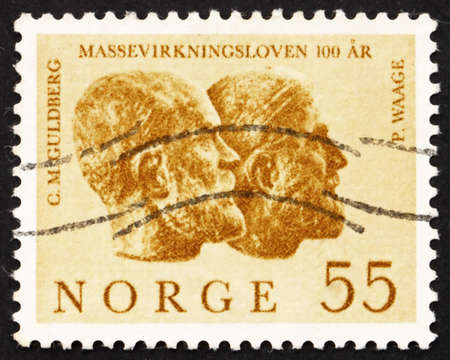 NORWAY - CIRCA 1964: a stamp printed in the Norway shows Cato M. Guldberg and Peter Waage by Stinius Fredriksen, circa 1964 Stock Photo - 12179629