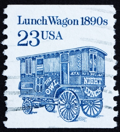 UNITED STATES OF AMERICA - CIRCA 1991: a stamp printed in the United States of America shows Lunch Wagon, 1890s, horse-drawn wagon, circa 1991 photo