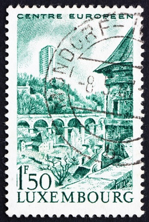 european community: LUXEMBOURG - CIRCA 1966: a stamp printed in the Luxembourg shows Tower Building, Kirchberg, Seat of European Community, circa 1966 Stock Photo