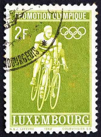 LUXEMBOURG - CIRCA 1968: a stamp printed in the Luxembourg shows Bicycling, 19th Olympic Games, Mexico City, circa 1968 photo