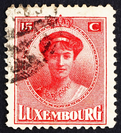 reign: LUXEMBOURG - CIRCA 1921: a stamp printed in the Luxembourg shows Charlotte, Grand Duchess of Luxembourg, Reign from 1919 to 1964, circa 1921 Editorial