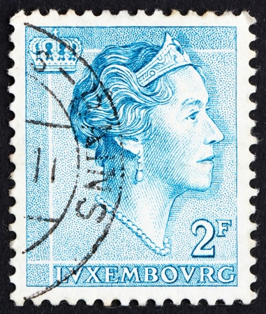 reign: LUXEMBOURG - CIRCA 1961: a stamp printed in the Luxembourg shows Charlotte, Grand Duchess of Luxembourg, Reign from 1919 to 1964, circa 1961