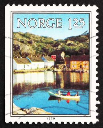 NORWAY - CIRCA 1979: a stamp printed in the Norway shows Boat on Skjernoysund, near Mandal, circa 1979 photo