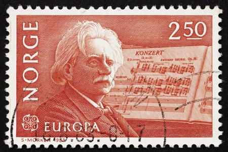 concerto: NORWAY - CIRCA 1983: a stamp printed in the Norway shows Edvard Grieg, Composer and his Piano Concerto in A-minor, circa 1983