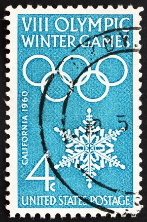UNITED STATES OF AMERICA - CIRCA 1960: a stamp printed in the USA shows Olympic Rings and Snowflake, 8th Olympic Winter Games Squaw Valley, circa 1960