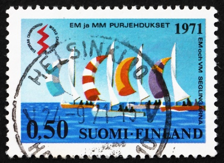 FINLAND - CIRCA 1971: a stamp printed in the Finland shows Sailboats, International Lightning Class Championships, Helsinki, circa 1971 photo
