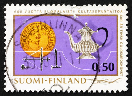 guilds: FINLAND - CIRCA 1971: a stamp printed in the Finland shows Silver Tea Pot, Guild's Emblem and Tools, 600th Anniversary of Finnish goldsmiths' art, circa 1971