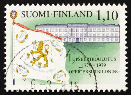 FINLAND - CIRCA 1979: a stamp printed in the Finland shows Old School, Hamina, Academy Flag, 200th Anniversary of Finnish Military Academy, circa 1979 Stock Photo - 12503995