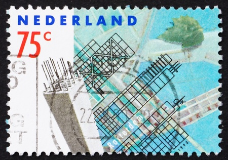 bombardment: NETHERLANDS - CIRCA 1990: a stamp printed in the Netherlands shows Modern Buildings, Rotterdam Reconstruction after devastating bombardment in WWII, circa 1990