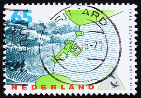 NETHERLANDS - CIRCA 1986: a stamp printed in the Netherlands shows Storm-surge Barrier, Delta Project Completion, circa 1986 photo