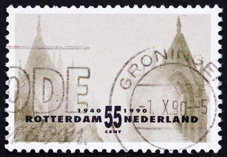 bombardment: NETHERLANDS - CIRCA 1990: a stamp printed in the Netherlands shows Two Old Towers, Rotterdam Reconstruction after devastating bombardment in WWII, circa 1990