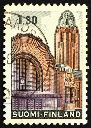 FINLAND - CIRCA 1971: a stamp printed in the Finland shows Helsinki Central Railway Station, circa 1971 photo