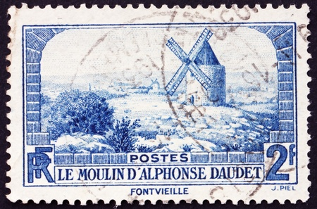 FRANCE - CIRCA 1936: a stamp printed in the France shows Windmill at Fontvielle, 70th Anniversary of Alphonse Daudet�s Lettres de mon Moulin, circa 1936 Stock Photo - 12504119