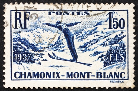 FRANCE - CIRCA 1937: a stamp printed in the France shows Ski Jumper, International Ski Meet at Chamonix, Mont Blanc, circa 1937 Stock Photo - 12504114