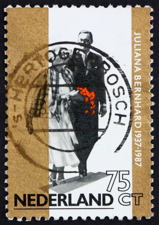 NETHERLANDS - CIRCA 1987: a stamp printed in the Netherlands shows Princess Juliana and Prince Bernhard, 50th Wedding Anniversary, circa 1987