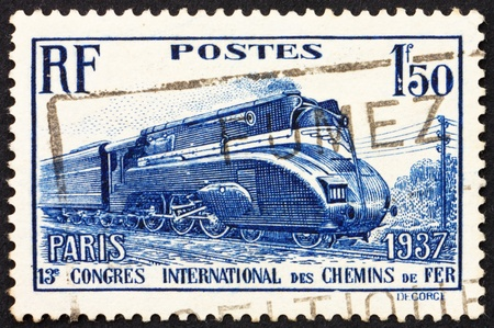 streamlined: FRANCE - CIRCA 1937: a stamp printed in the France shows Streamlined Locomotive, 13th International Railroad Congress, circa 1937