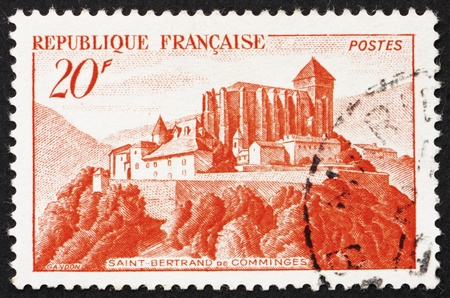 FRANCE - CIRCA 1933: a stamp printed in the France shows Abbey of St. Bertrand de Comminges, circa 1933 Stock Photo - 12504128