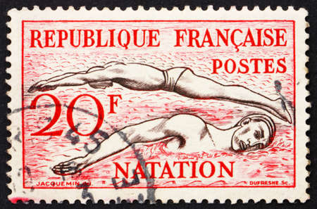 FRANCE - CIRCA 1953: a stamp printed in the France shows Swimming, circa 1953 photo