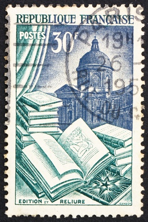 cancelled stamp: FRANCE - CIRCA 1954: a stamp printed in the France shows Books, Book Manufacture, circa 1954