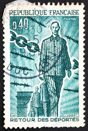 deported: FRANCE - CIRCA 1965: a stamp printed in the France shows Returning Deportees, 1945, 20th Anniversary of the Return of People Deported during WWII, circa 1965