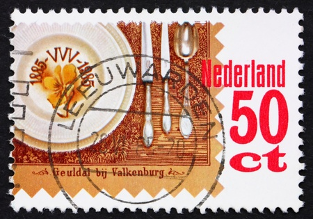 NETHERLANDS - CIRCA 1985: a stamp printed in the Netherlands shows Place setting, circa 1985 photo