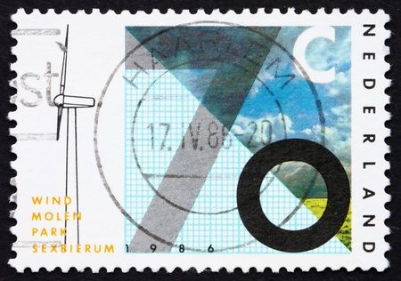 NETHERLANDS - CIRCA 1986: a stamp printed in the Netherlands shows Sexbierum Windmill Test Station Inauguration, circa 1986 photo