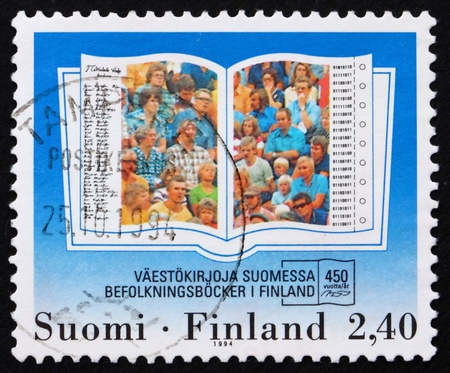 FINLAND - CIRCA 1994: a stamp printed in the Finland shows Population Registers, 450th Anniversary, circa 1994 photo