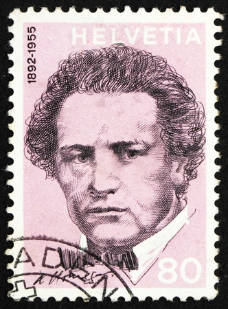 SWITZERLAND - CIRCA 1972: a stamp printed in the Switzerland shows Arthur Honegger, Composer, circa 1972 Stock Photo - 12504425