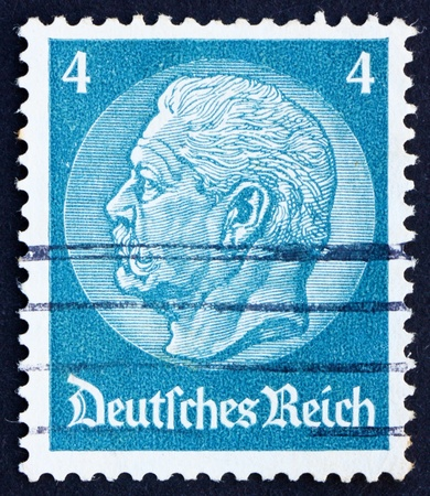 GERMANY - CIRCA 1932: a stamp printed in the Germany shows Paul von Hindenburg, 2nd President of the German Reich, circa 1928 Stock Photo - 12839986