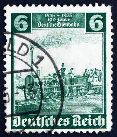GERMANY - CIRCA 1935: a stamp printed in the Germany shows The Eagle, Engine, Centenary of Railroad in Germany, circa 1935 photo
