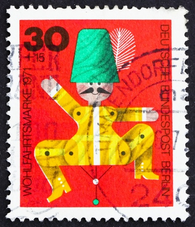 GERMANY - CIRCA 1971: a stamp printed in the Germany, Berlin shows Jumping Jack, Wooden Toy, circa 1971 photo